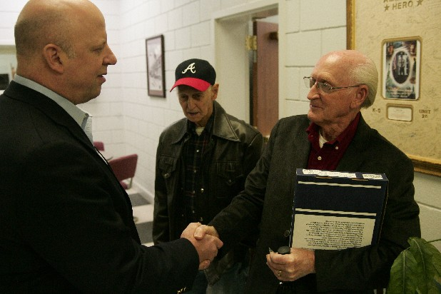 U.S. Congressman Scott DesJarlais presents a flag to Carl Schoenmann, brother of Private First Class Glenn Schoenmann, on Wednesday at the Grundy County Courthouse. Glenn Schoenmann reportedly died as a prisoner of war on December 29, 1950 but his remains were not identified until December 2012.