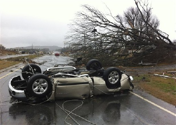 A vehicle lies on a road Wednesday after a tornado moved through Adairsville, Ga. A fierce storm system that roared across northwest Georgia has left at least one person dead and a trail of damage that included demolished buildings in downtown Adairsville and vehicles overturned on Interstate 75 northwest of Atlanta.