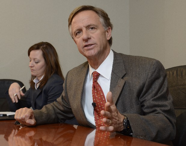 Tennessee Gov. Bill Haslam answers questions during a meeting with the Times Free Press editorial board. At left is Alexia Poe, director of communications for the state of Tennessee.