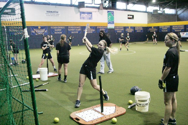 The UTC Lady Mocs softball team practices Thursday at the UTC softball indoor hitting facility at Warner Park. Their first game of the season is at the National Training Center Invitational in Clermont, Fla. on Feb. 8.