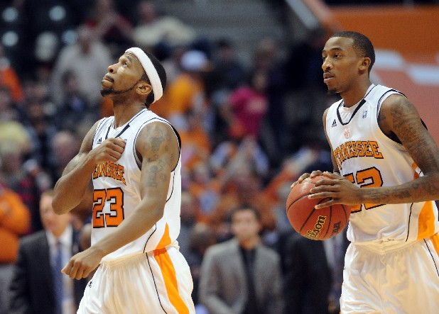 Tennessee guard Cameron Tatum (23) pounds his chest before pointing to the rafters while teammate Jordan McRae looks on.