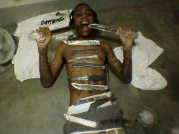 Another Hays state inmate showing off his shanks. This photo was found on an inmate's phone.
