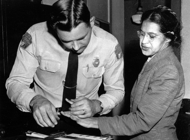 Rosa Parks is fingerprinted Feb. 22, 1956, by police Lt. D.H. Lackey in Montgomery, Ala., two months after refusing to give up her seat on a bus for a white passenger on Dec. 1, 1955.