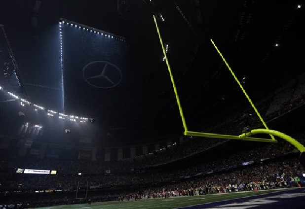 Half the lights are out in the Superdome during a power outage Sunday in the second half of the NFL Super Bowl XLVII football game between the San Francisco 49ers and Baltimore Raven in New Orleans.