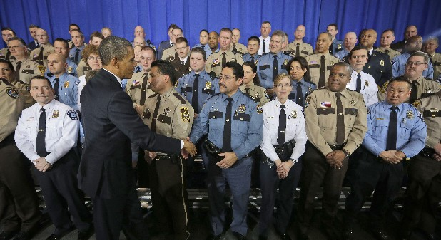 President Barack Obama greets law enforcement officers after speaking on ideas to reduce gun violence Monday at the Minneapolis Police Department.