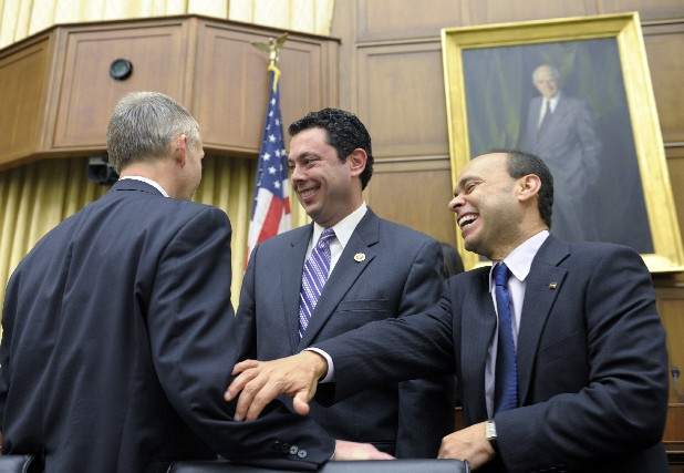 Rep. Jason Chaffetz, R-Utah, center, and Rep. Luis Gutierrez, D-Ill., right, share a laugh with Rep. Trey Gowdy, R-S.C., left, before the House Judiciary Committee hearing on America's Immigration System on Capitol Hill in Washington on Tuesday.