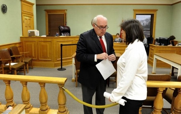 Attorney James Logan talks with Lisa Burris in Roane County Probate Courtroom just before he was appointed administrator Tuesday, Feb. 5, 2013. Burris, Rocky Houston's sister, relinquished the role and Judge Jeffery Wicks approved her decision. (MICHAEL PATRICK/NEWS SENTINEL)