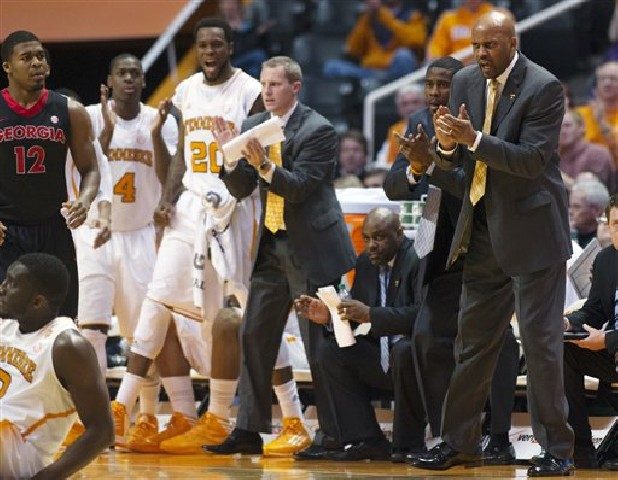 Tennessee head coach Cuonzo Martin cheers after a foul was called on Georgia during the first half of an NCAA college basketball game Wednesday in Knoxville.