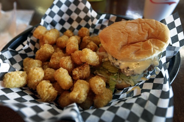 A hamburger and tater tots are served at a restaurant in Charlotte, N.C. Deep-fried foods may be causing trouble in the Deep South. People whose diets are heavy on them and sugary drinks were more likely to suffer a stroke, according to a new study released Thursday.