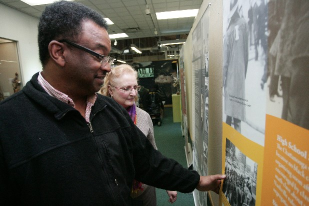 Dwight Ash looks at a banner depicting scenes from local sit-ins during the civil rights movement at the the Bessie Smith Cultural Center's Sit-in exhibit.