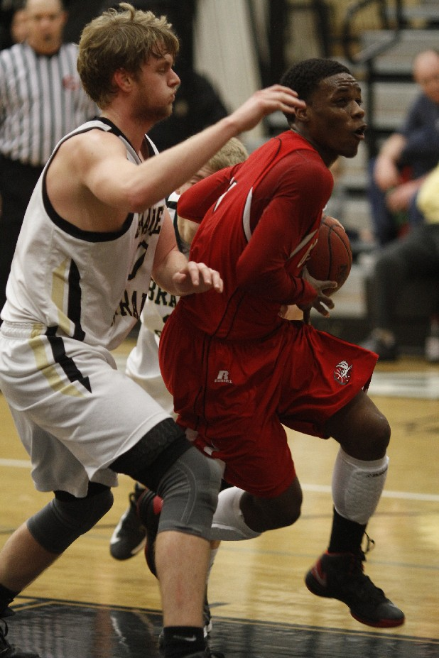 Ooltewah's Antonio Jackson (1) drives past Bradley Central's Matthew Whitmire Friday at Bradley Central.