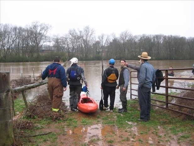In this file photo, searchers stand along the Polk-McMinn county line near the Hiwassee River and Delano Creek after three people went missing when their boat overturned.