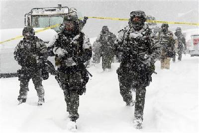 Hunt for ex-cop goes on amid California snowstorm | Times