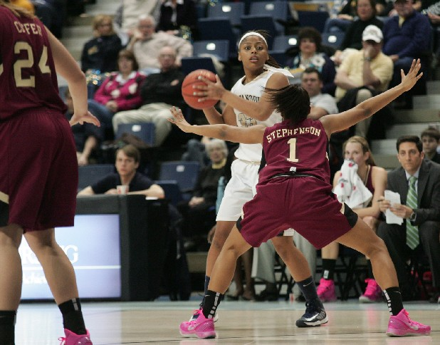 UTC's Tatianna Jackson looks for an open player while being guarded by Elon University's Zora Stephenson Saturday at McKenzie Arena.