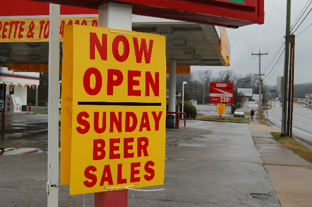Signs advertise Sunday sales of beer and wine at a gas station in Catoosa County in sight of Beverage World, a Fort Oglethorpe speciality beer and wine retailer that can't sell on Sunday, because its inside city limits.