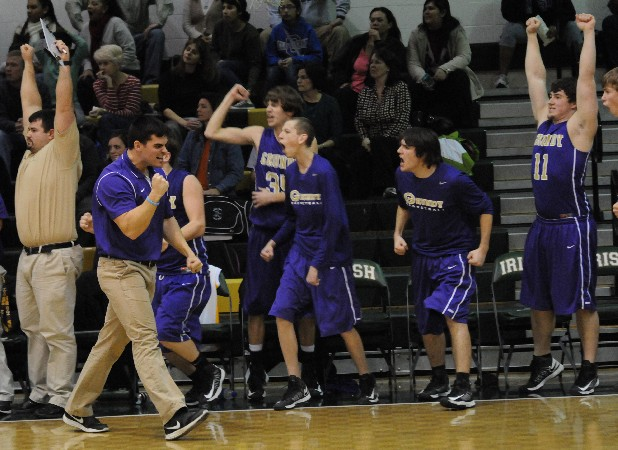 Grundy County basketball players celebrate after defeating Notre Dame in the District 7-AA quarterfinal game.
