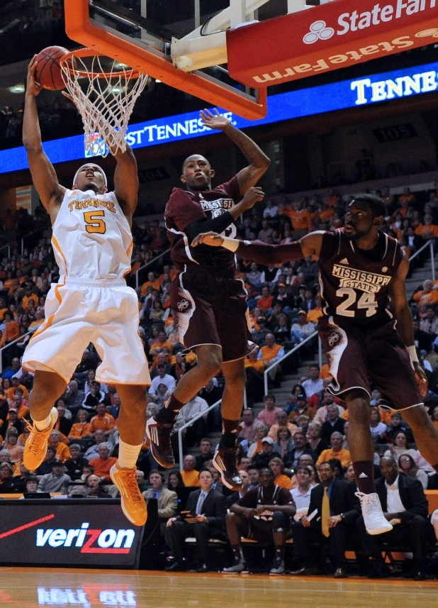 Tennessee forward Jarnell Stokes (5) drives for a basket against Mississippi State guard Craig Sword (32) and guard Tyson Cunningham (24).