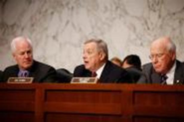 "In this Tuesday, June 28, 2011 file photo, Sen. Richard Durbin, D-Ill., center, flanked by Sen. John Cornyn, R-Texas, left, and Sen. Patrick Leahy, D-Vt., speaks during a meeting on Capitol Hill in Washington. The Senate holds its second hearing Tuesday, Feb. 12, 2013, on gun curbs since the December 2012 shooting deaths of 20 first-graders in Newtown, Conn. This time, a Senate Judiciary subcommittee is examining the constitutionality and effectiveness of federal firearms limits. ""We need to keep guns out of the hands of criminals and those who are mentally unstable,"" Durbin, D-Ill., said in a brief interview Monday, Feb. 11, 2013. ""I hope everyone will acknowledge what within our Constitution is not only an individual right to bear arms, but the collective right of Americans to be safe."""