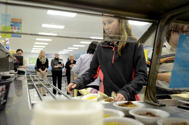 Sixth-grade student Savannah Ledford makes her way through the cafeteria line Wednesday at Soddy-Daisy Middle School. Lila Beazley, background center, a consultant with the state of Tennessee, visited the school on Wednsday to review their compliance with state nutritional guidelines. She is seen as she watches students choices along with state consultant Lindsay Steinhauer, left, and Judy Whitmire, right, area field supervisor for the Hamilton County Schools nutritional program.