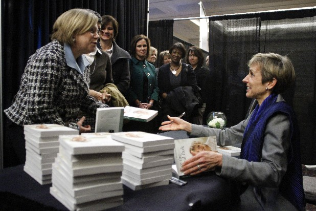 "Peggy Myers, left, has a book autographed by Trisha Meili ""The Central Park Jogger"" after Meili spoke during Siskin Hospital's 10th anniversary Possibilities Luncheon at the Chattanooga Convention Center on Wednesday."