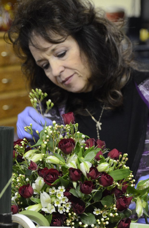Designer Renee Grooms finishes a floral arrangement Wednesday at Chattanooga Florist.