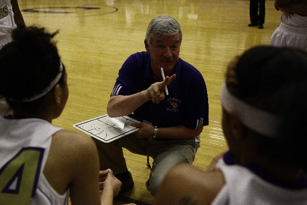 Central High School girls basketball coach Rick May talks to his players before a game with East Hamilton.