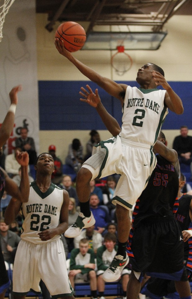 Notre Dame's Stedmon Ford (2) takes the ball to the basket while teammate Kealey Green (22) looks on and Red Bank's Trydal Autry (55) defends.