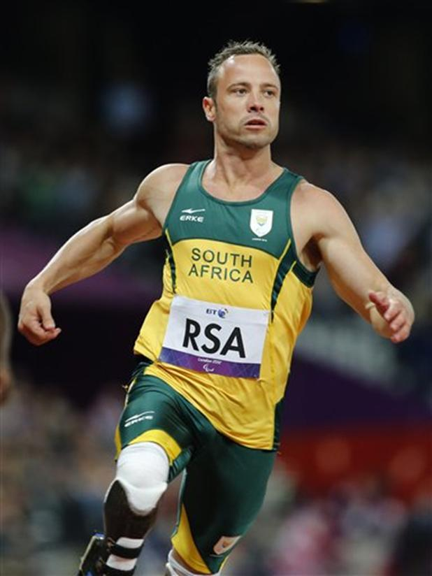 In this Wednesday, Sept. 5, 2012 file photo, South Africa's Oscar Pistorius wins the Men's 4 x 100 Relay T42-46 final at the 2012 Paralympics in London. Pistorius has been arrested after a 30-year-old woman was shot dead at his home in South Africa, early Thursday, Feb. 14, 2013.