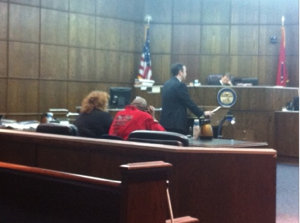 Frederick Anderson is seated on the right with defense attorney Donna Miller.