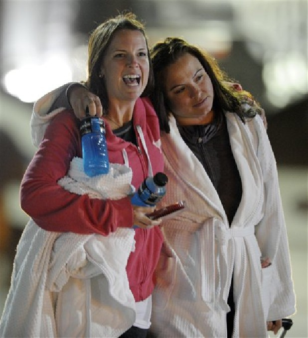 Kristina Courson, left, of Paris, Texas, is embraced by Jamie Hilliard, of Denison, Texas, after getting off the cruise ship Carnival Triumph in Mobile, Ala., Thursday, Feb. 14, 2013. The ship with more than 4,200 passengers and crew members has been idled for nearly a week in the Gulf of Mexico following an engine room fire.