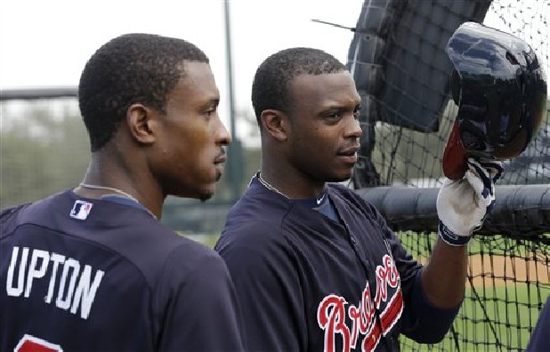 Atlanta Braves outfielder B.J. Upton (2) and his brother Justin Upton wait Friday to bat during a spring training baseball workout in Kissimmee, Fla.