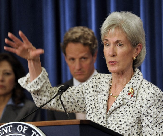 Health and Human Services Secretary Kathleen Sebelius gestures while speaking during a news conference. President Barack Obama's health care overhaul is unfolding as a national experiment with American consumers as the guinea pigs: Who will do a better job getting uninsured people covered, the states or the feds?