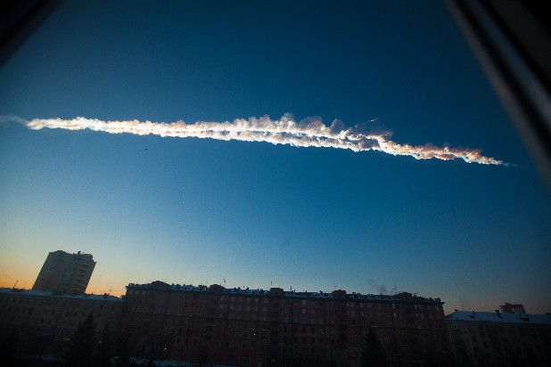 A meteorite contrail is seen over Chelyabinsk, Russia, on Friday. The meteor streaked across the sky of Russia's Ural Mountains on Friday morning, causing explosions and reportedly injuring more than 1,000 people, including many hurt by broken glass.
