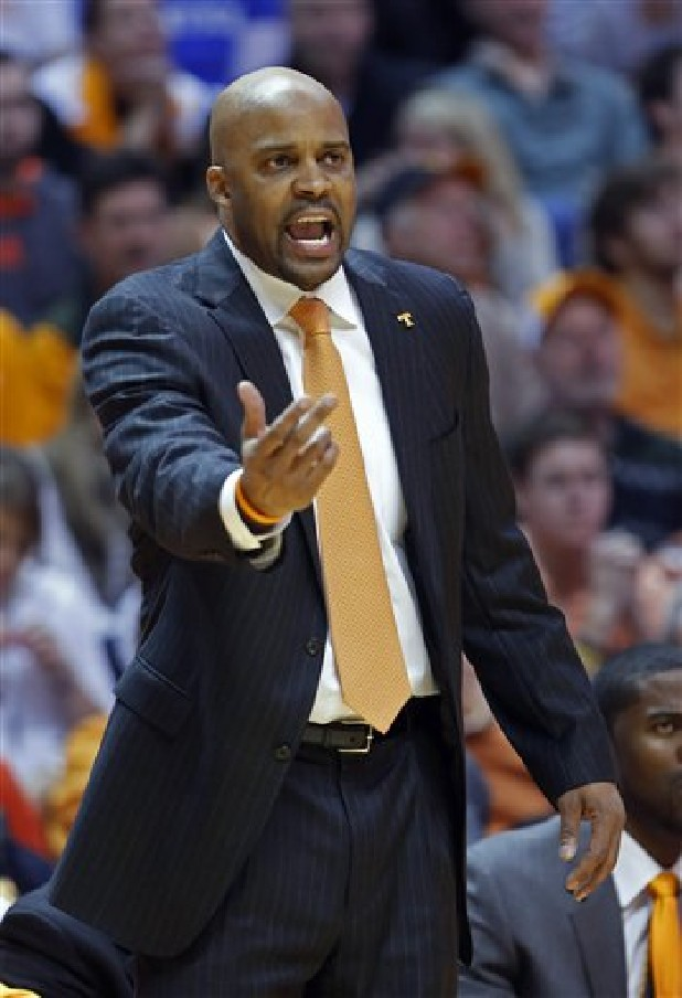 Tennessee head coach Cuonzo Martin directs his team Saturday in the first half of an NCAA college basketball game against Kentucky in Knoxville. Tennessee won 88-58.