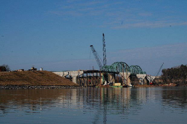 Crews at the Marion Memorial Bridge replacement project in Haletown, Tenn., excavate the Tennessee River bottom for the seventh and last pier for a new $21.5 million bridge that will replace the eight-decade-old truss-style bridge.