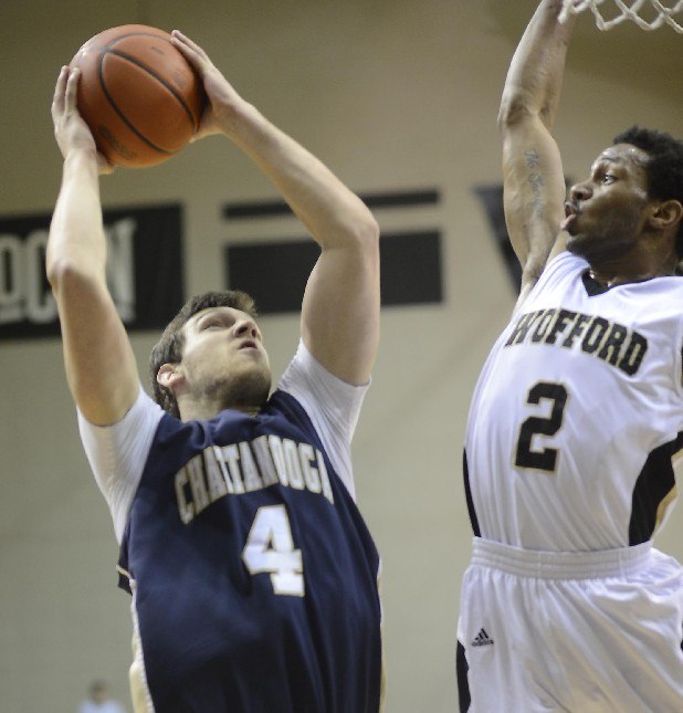 UTC's Sam Watson goes to the basket against Wofford's Karl Cochran (2) in the Mocs' 78-58 loss Saturday. Spartanburg Herald Journal Photo