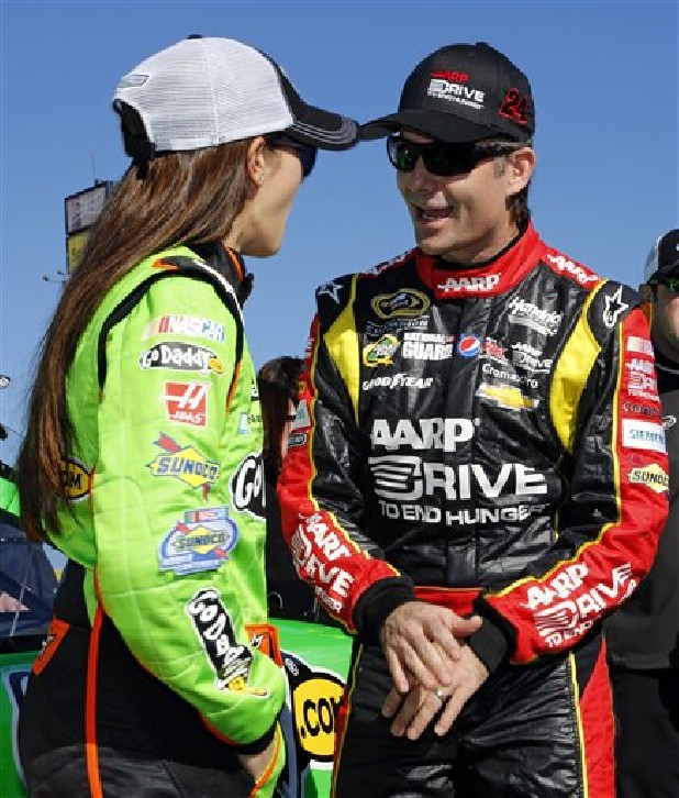 Dancia Patrick, left, and Jeff Gordon talk after qualifying Sunday for the NASCAR Daytona 500 Sprint Cup Series auto race at Daytona International Speedway in Daytona Beach, Fla. Patrick won the pole, becoming the first woman to secure the top spot for any Sprint Cup race.
