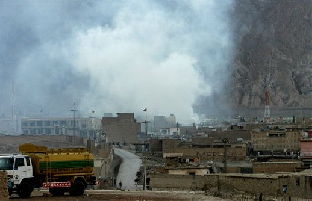 Smoke rises Saturday from the site of a bomb blast in a market in Quetta, Pakistan. Senior police officer Wazir Khan Nasir said the bomb went off in a Shiite Muslim-dominated residential suburb of the city of Quetta. Residents rushed the victims to three different hospitals