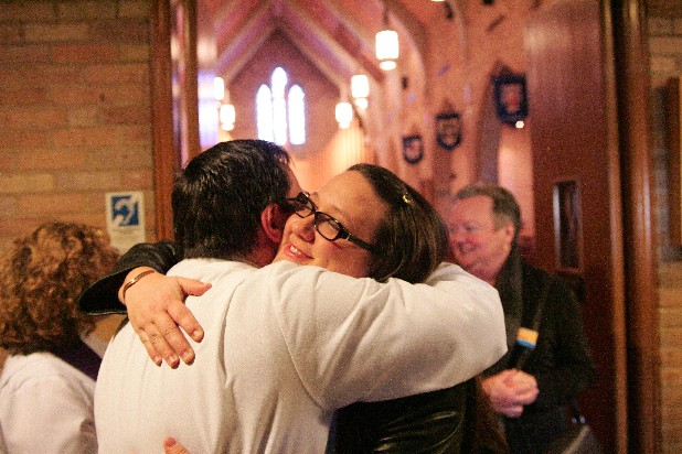 Erik Broeren, associate for pastoral care, hugs Meredith Ogle after the Sunday morning service at Grace Episcopal Church on Belvoir Avenue.