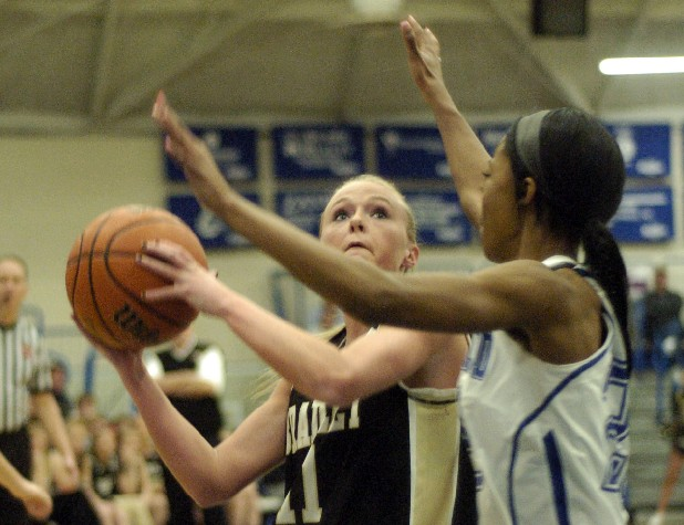 Bradley Central's Brandi Whitted shoots against Cleveland's Qetuwrah Abdullah-Muhammad.  Bradley defeated Cleveland 51-42 in the District 5-AAA girls' championship game Monday at the Cleveland High gym.