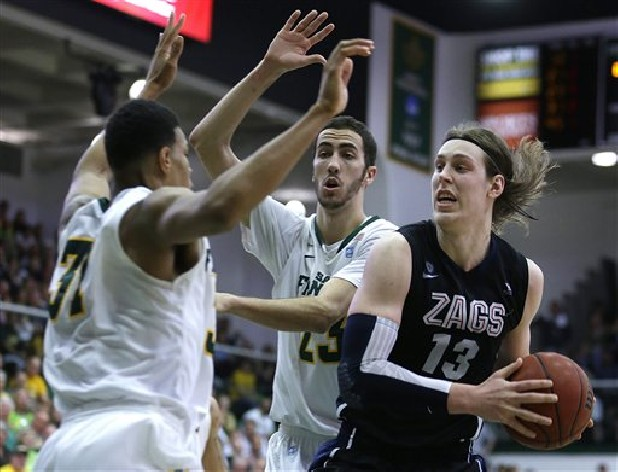 San Francisco's Frank Rogers, left, and Mark Tollefsen defend against Gonzaga's Kelly Olynyk (13) during the second half of an NCAA college basketball game in San Francisco.