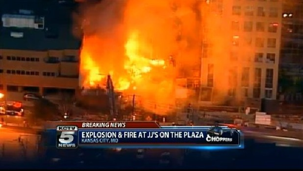 In this image taken from video from KCTV, firefighters battle a massive fire at Country Club Plaza in Kansas City, Mo.