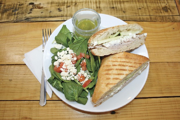 The turkey panini includes goat cheese, Granny Smith apples and honey. It's served with a side salad with homemade pesto.