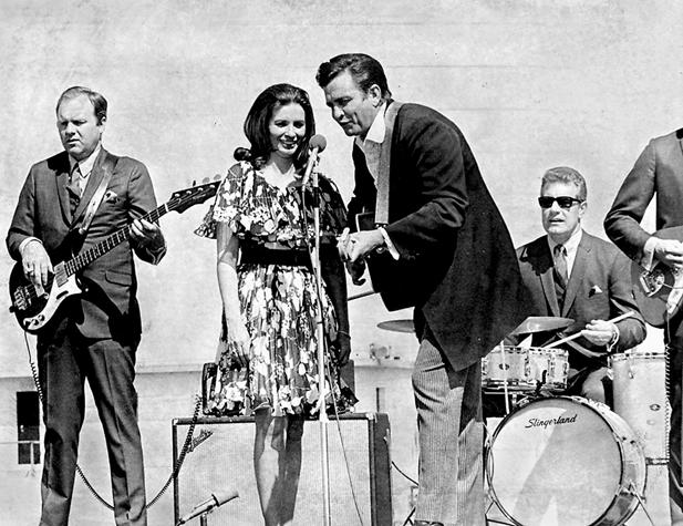 Johnny Cash, center, performs with his wife, June Carter Cash, in 1969 at Arkansas' Cummins Prison. Cash's longtime drummer, W.S. Holland, rear, will perform at the Johnny Cash Birthday Bash at Rhythm & Brews on Saturday.