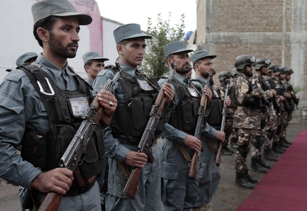 Afghan soldiers stand at attention during the third phase of a transfer of authority ceremony from the NATO- led troops to Afghan security forces in Kunar province, east of Kabul, Afghanistan.