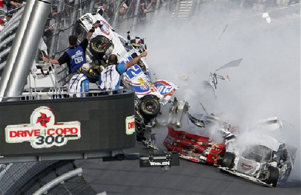 Kyle Larson's car (32) gets airborne during a multi-car wreck on the final lap of the NASCAR Nationwide Series auto race Saturday at Daytona International Speedway in Daytona Beach, Fla.