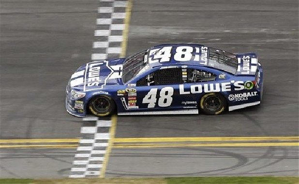 Jimmie Johnson crosses the finish line to win the Daytona 500 NASCAR Sprint Cup Series auto race Sunday at Daytona International Speedway in Daytona Beach, Fla.
