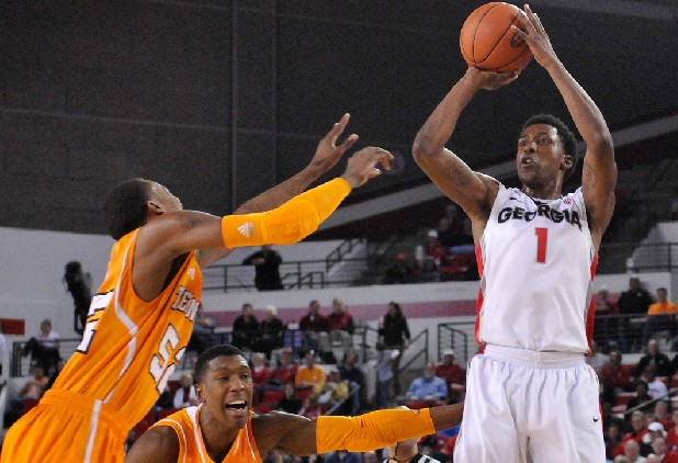 Georgia guard Kentavious Caldwell-Pope (1) shoots a three-point basket while defended by Tennessee guards Jordan McRae (52) and guard Josh Richardson (1) on Saturday in Athens, Ga.