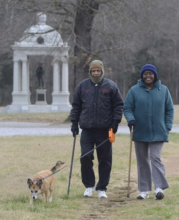 Robert and Winifred Bray walk with their dog, Magic, at the Chickamauga Battlefield.