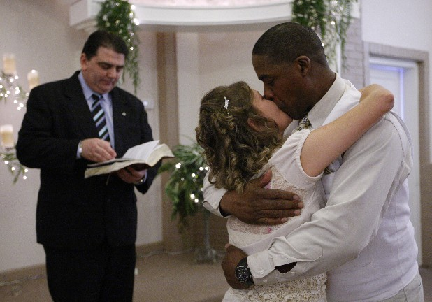 George and Pam Fleetwood kiss after being married by minister Troy Simmons Friday at the Ringgold Wedding Chapel.